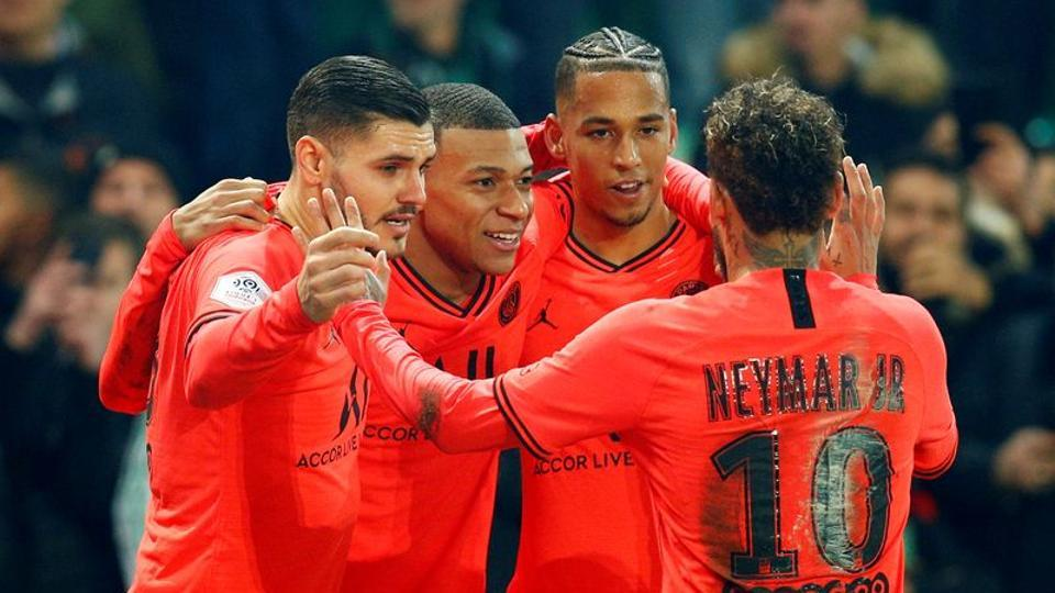 Paris St Germain's Kylian Mbappe celebrates scoring their fourth goal with Neymar and teammates