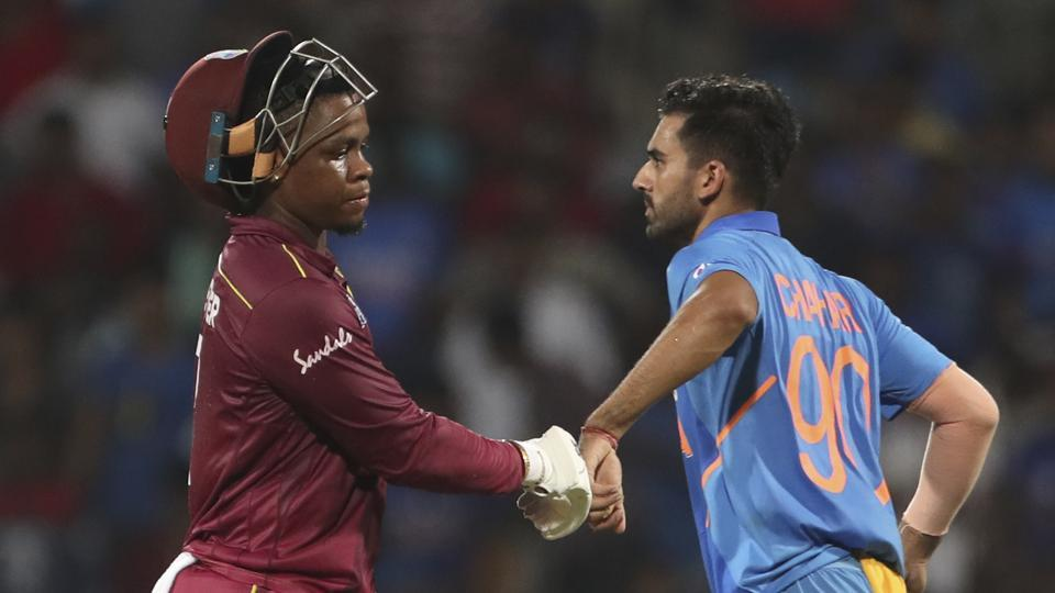 India's Deepak Chahar, right, touches the hand of West Indies' Shimron Hetmyer as he leaves the field after losing his wicket during the first one day international cricket match between India and West Indies in Chennai, India, Sunday, Dec. 15, 2019. (AP Photo/Aijaz Rahi)