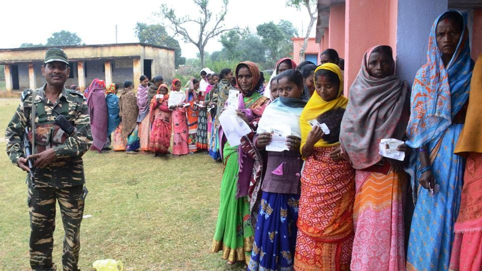 Villagers of Jitpur in qeueu to vote 4th phase of assembly election at middle school, Tundi block in Dhanbad on Monday, December 16,2019-