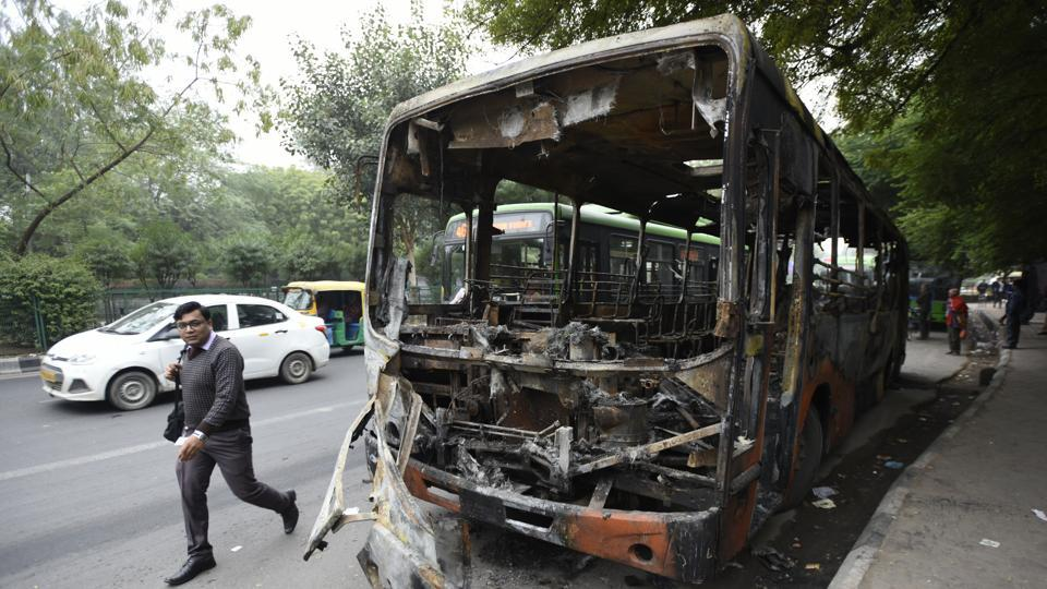 A bus that was set on fire by protesters at Mathura road, New Delhi, on Monday, December 16, 2019.
