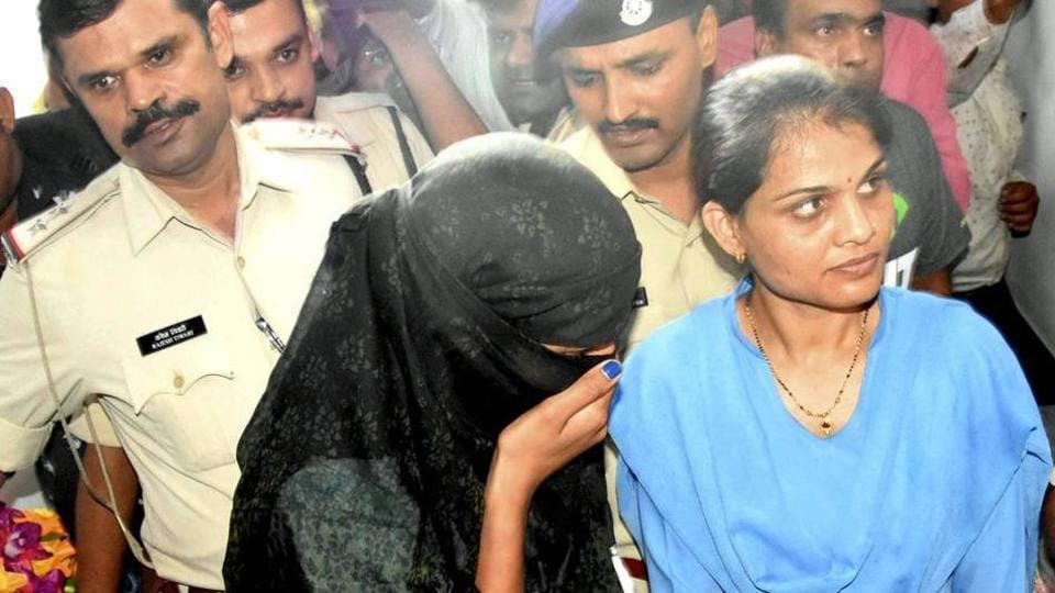 Indore police produce Monika Yadav, one of the accused in extortion case during a court appearance in  Bhopal,