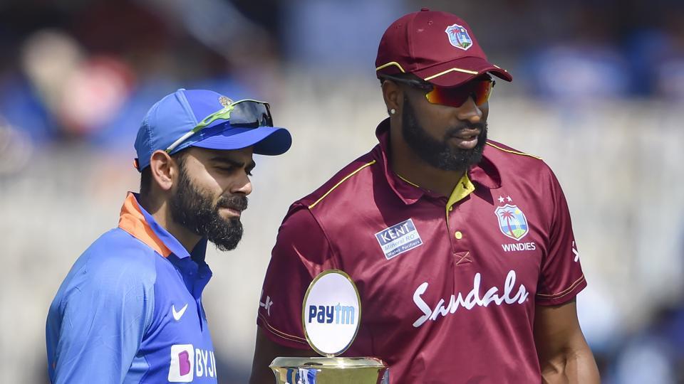 Indian captain Virat Kohli with West Indies captain Kieron Pollard.