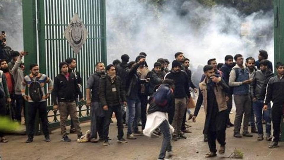 Police uses tear gas to disperse students protesting outside the Jamia Millia Islamia University against the Citizenship Amendment Bill, in New Delhi, India, Friday, Dec. 13, 2019.
