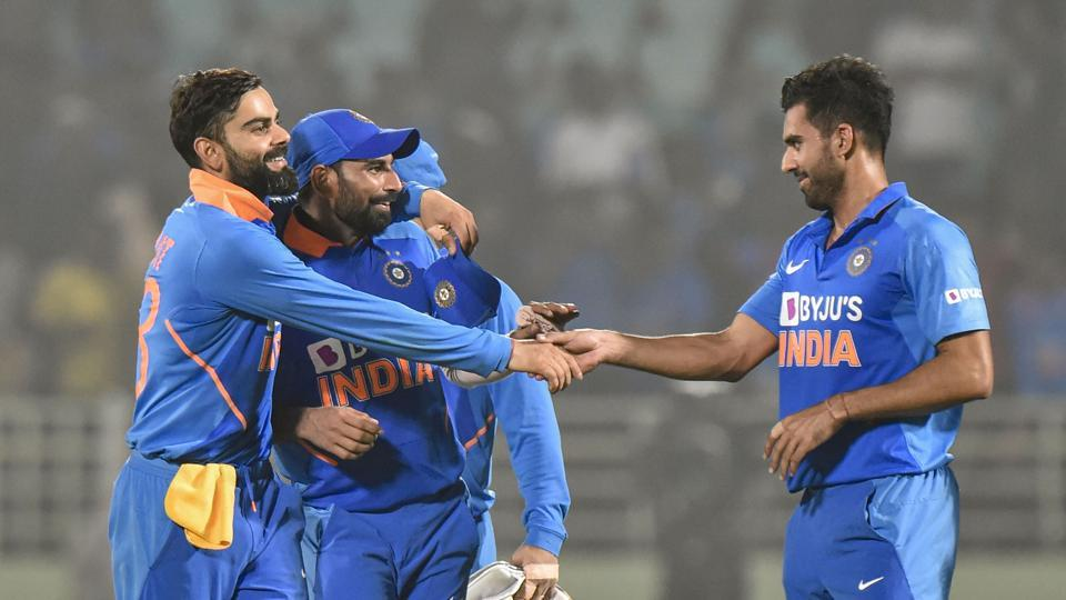 Indian captain Virat Kohli celebrates with pacers Md Shami and Deepak Chahar after their win in the 2nd ODI against West Indies at ACA-VDCA Cricket Stadium in Visakhapatnam.