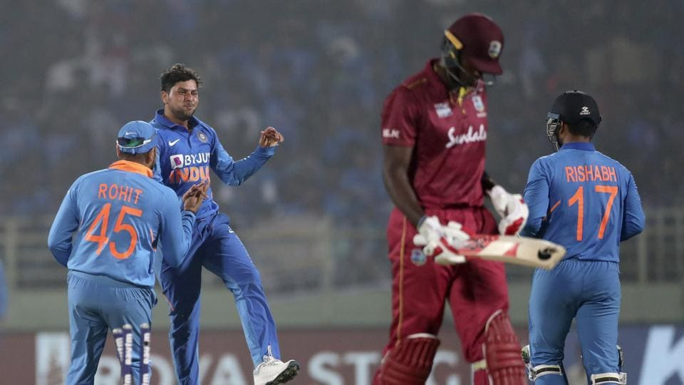India's Kuldeep Yadav celebrates the dismissal of West Indies' Jason Holder during the second one day international cricket match between India and West Indies in Visakhapatnam, India.