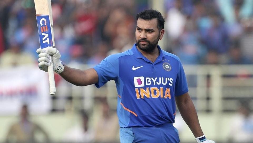Rohit Sharma celebrates scoring a century during the second ODI between India and West Indies in Visakhapatnam.