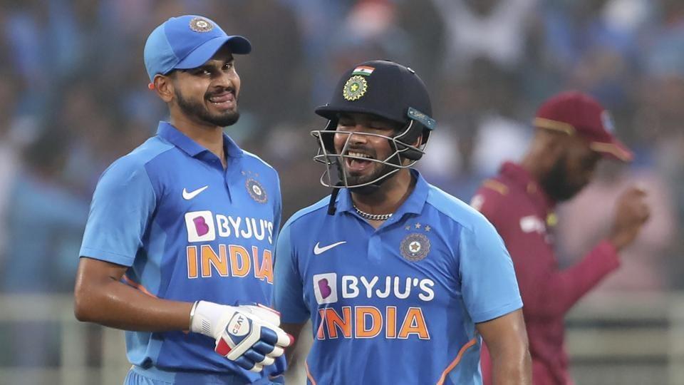 India's Shreyas Iyer, left, and Rishabh Pant celebrate scoring runs.