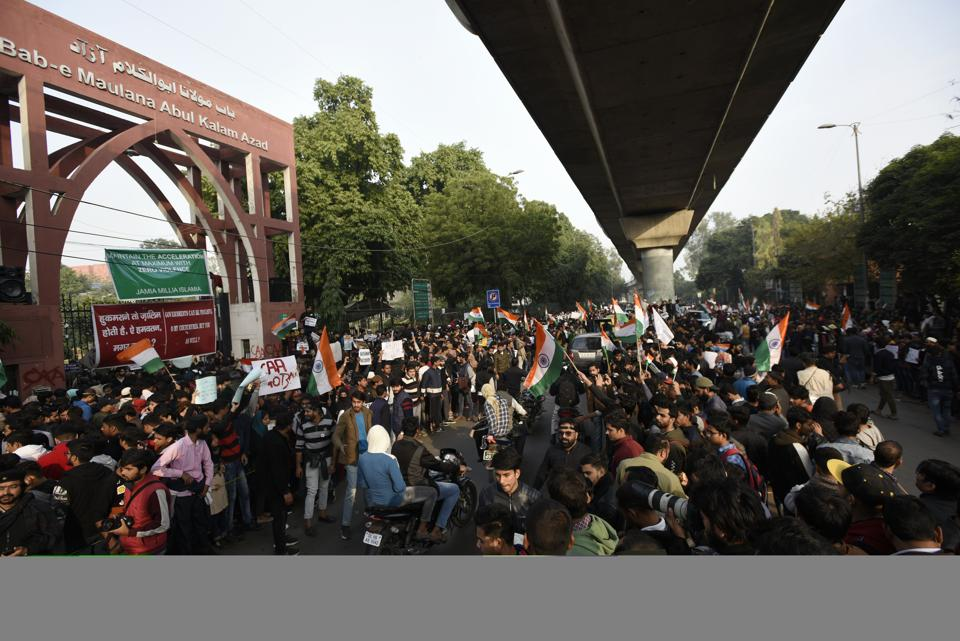 Students and local residents hold placards and raise slogans as they take part in a protest against the Citizenship Amandment Act (CAA) and National Register of Citizens (NRC), at Jamia Millia Islamia University, in New Delhi, India, on Wednesday, December 18, 2019.