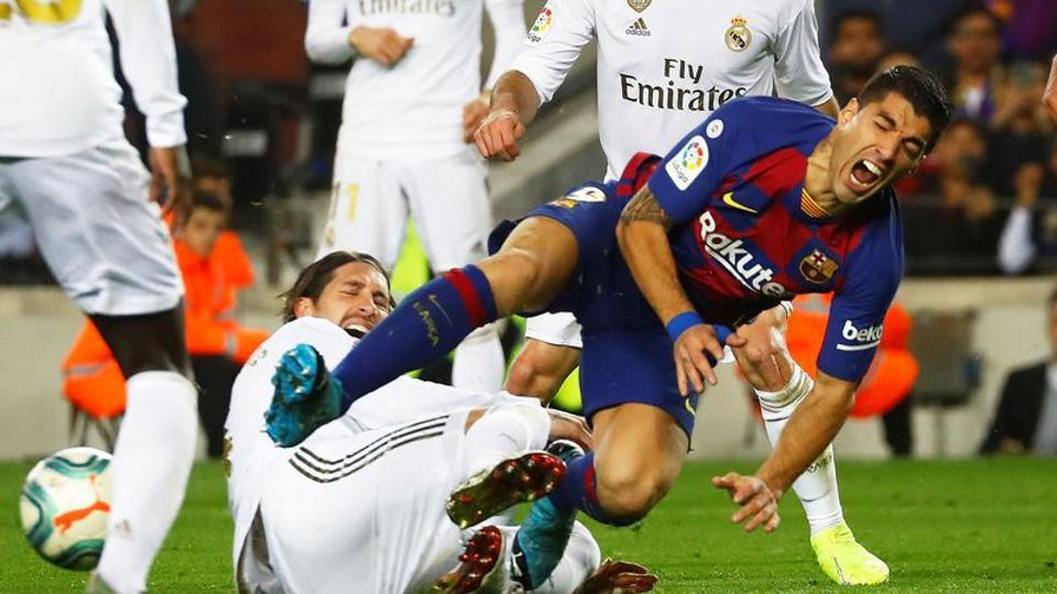 Real Madrid's Sergio Ramos in action with Barcelona's Luis Suarez