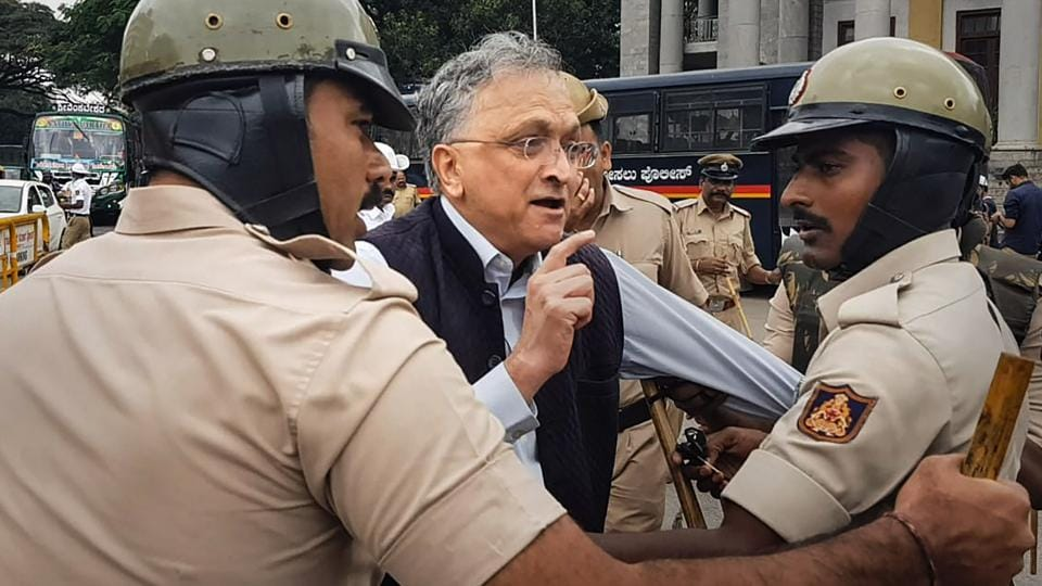 Noted historian Ramachandra Guha being detained by police during a protest against an amended Citizenship Bill.