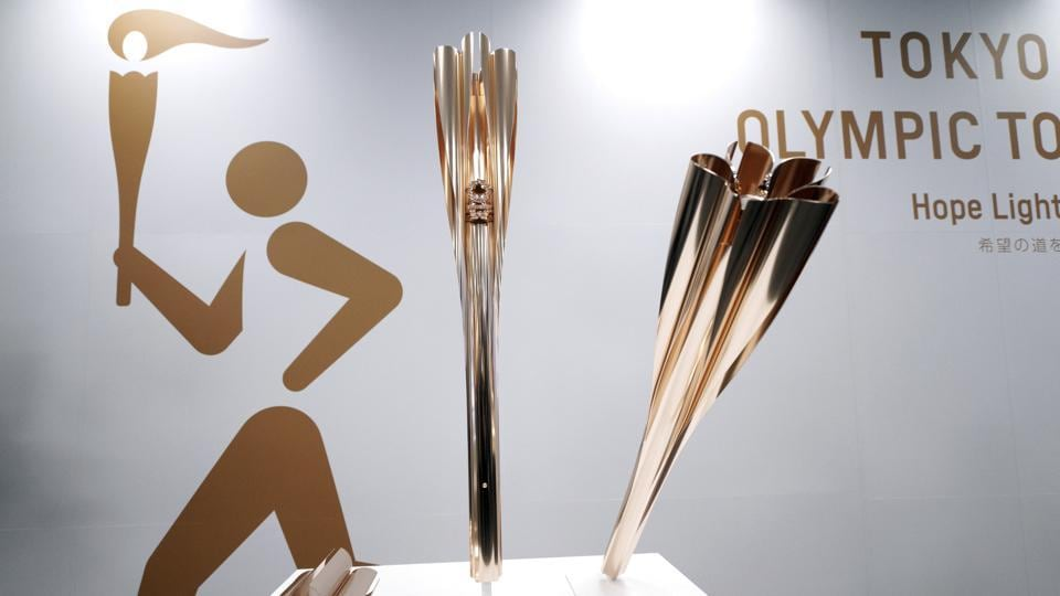 In this March 20, 2019, file photo, Olympic torches of the Tokyo 2020 Olympic Games
