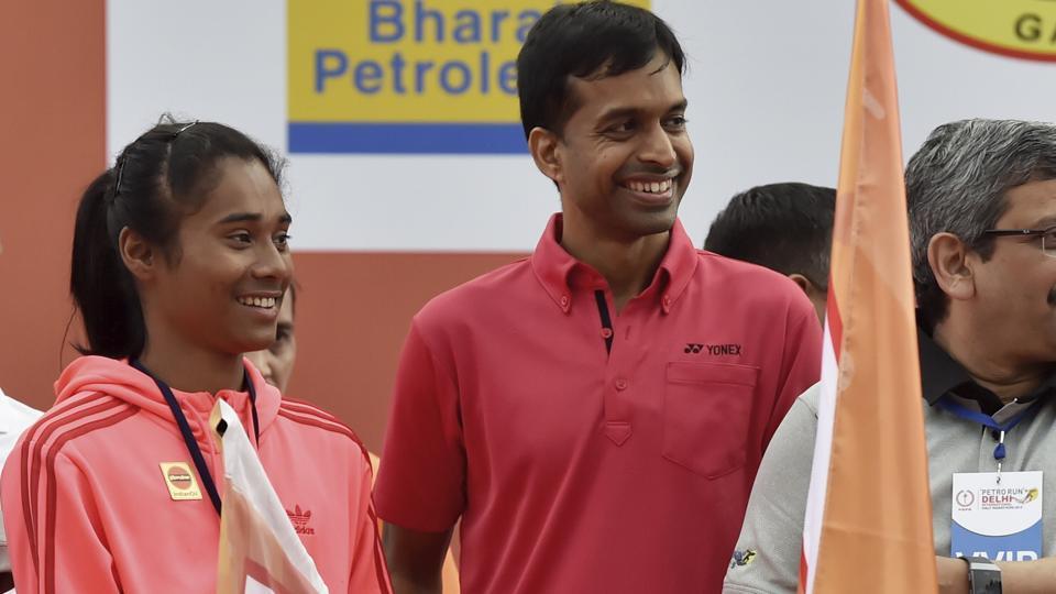 Indian badminton coach Pullela Gopichand and Athlete Hima Das.