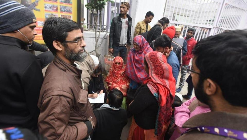 Lawyer seen helping in filling form to represent those who are arrested by the Delhi police yesterday at daryaganj police station in New Delhi on Saturday.