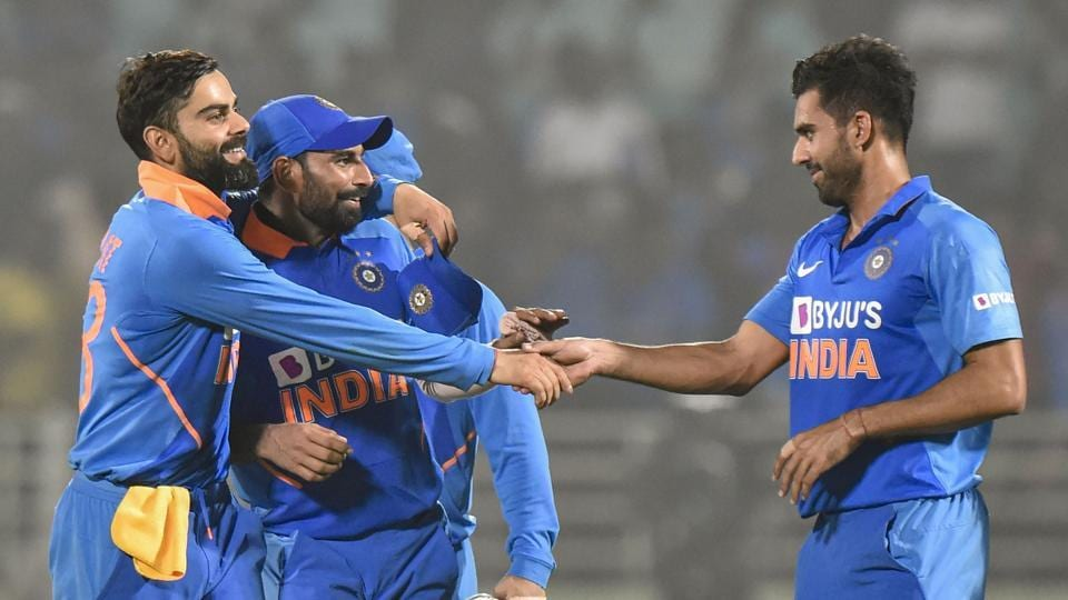 Indian captain Virat Kohli celebrates with pacers Md Shami and Deepak Chahar after their win in the 2nd ODI cricket match against West Indies at ACA-VDCA Cricket Stadium in Visakhapatnam, Wednesday, Dec. 18, 2019.