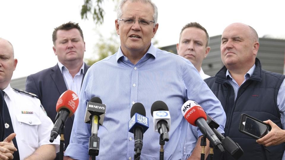 Australia's Prime Minister Scott Morrison speaks to the media during a visit to the Wollondilly Emergency Control Centre in Sydney, Sunday, Dec. 22, 2019.