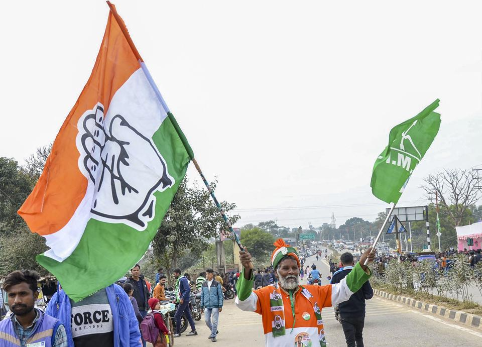 A supporter of Congress and Jharkhand Mukti Morcha (JMM)celebrates as they lead during counting of Jharkhand Assembly election votes, in Ranchi on Monday.