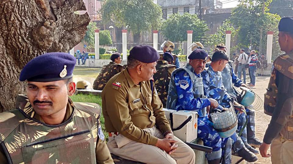 Security forces keeping a strict vigil at a polling station during the fifth phase of the Jharkhand Assembly Election in Santhal on Friday.