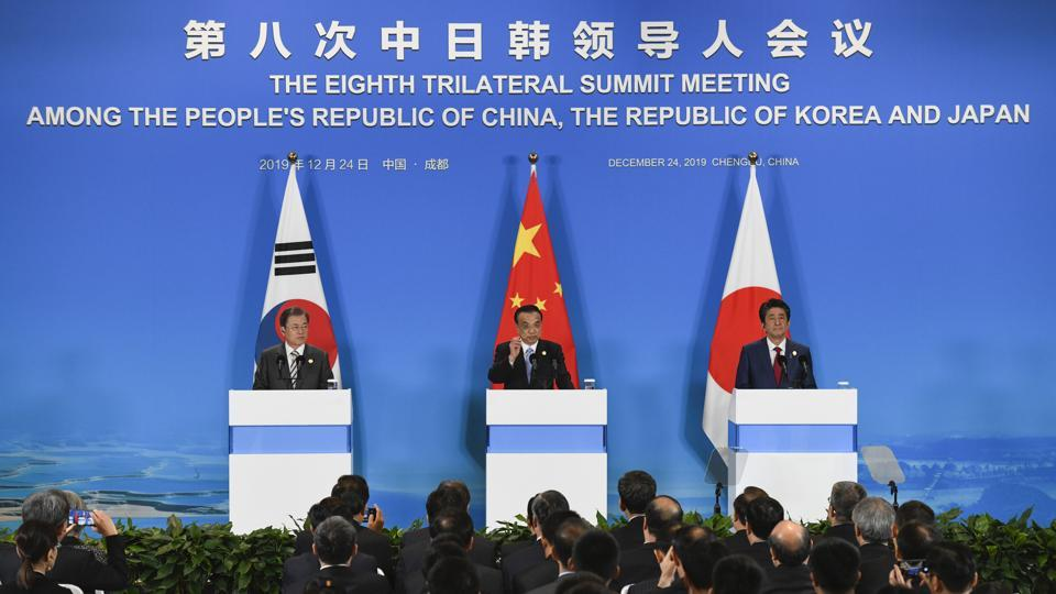 China's Premier Li Keqiang, center, speaks, as South Korea's President Moon Jae-in, left, and Japanese Prime Minister Shinzo Abe, right, listen to him during a joint press conference after their trilateral leaders' meeting in Chengdu, southwest China's Sichuan on December 24th.
