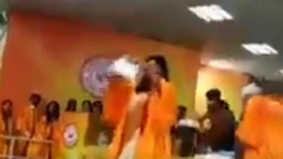 Debosmita Choudhury, Jadavpur University student, tears up a copy of citizenship law. (Photp: Videograb)