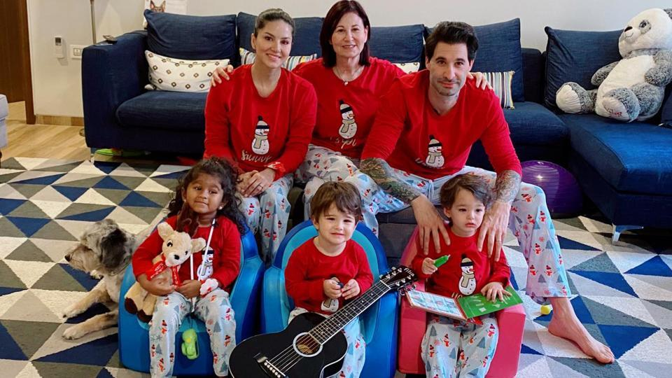 Sunny Leone poses for a family Christmas photo.