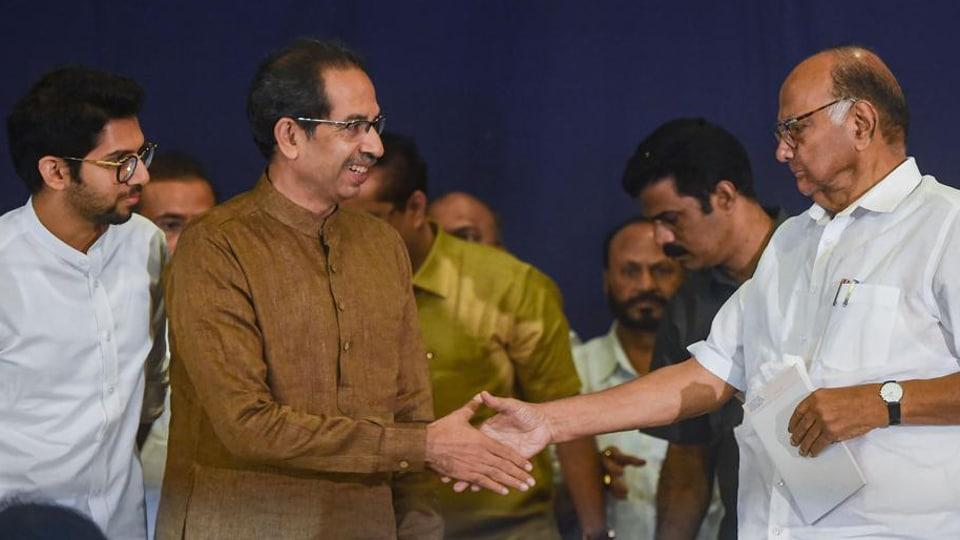 NCP President Sharad Pawar and Shiv Sena Chief Uddhav Thackeray shake hands during a joint press conference, in Mumbai, in November.