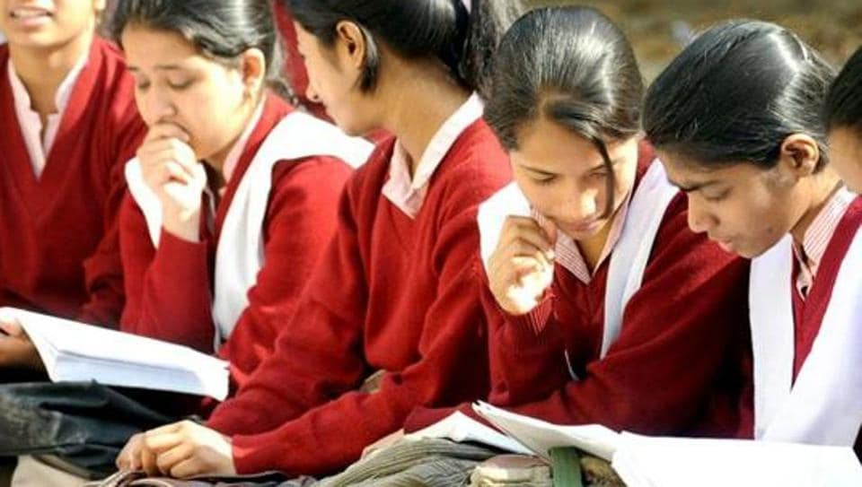 Students prepare for their CBSE senior school certificate examinations for Class XII standard, at the last moments before entering an examination hall in New Delhi