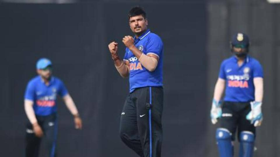 India A bowler Karn Sharma (C) celebrates after taking the wicket of New Zealand captain Kane Williamson.