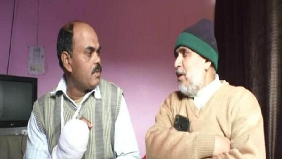 Policeman Ajay Kumar (left) with Hajji Qadir.