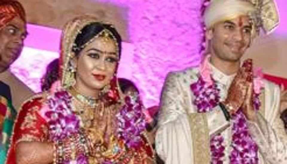 RJD chief Lalu Prasad's elder son Tej Pratap and Aishwarya Rai during their wedding ceremony in Patna.