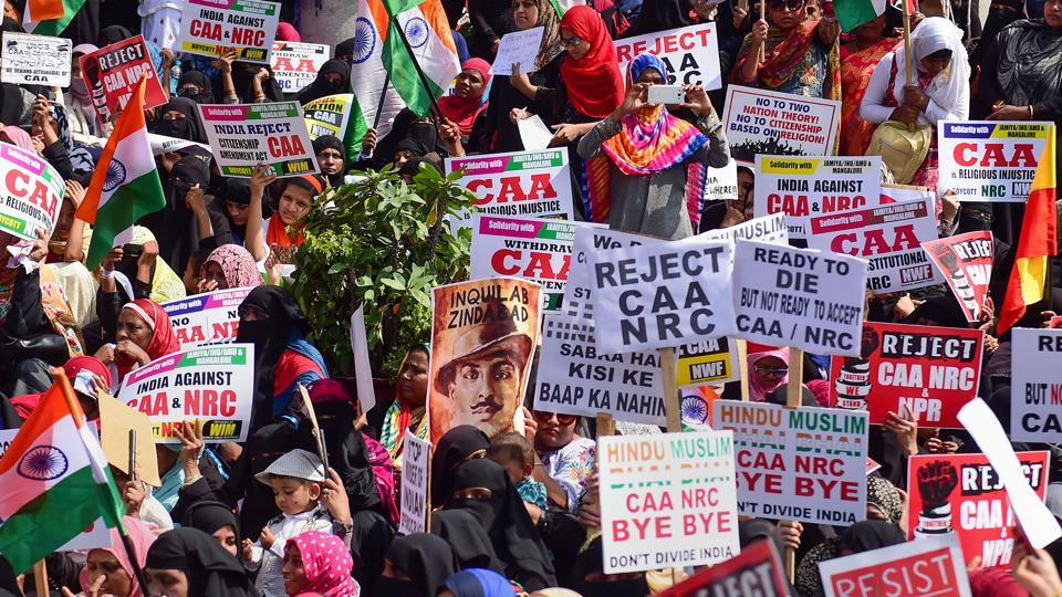 Members of Women India Movement display placards and raise slogans during a protest against the Citizenship (Amendment) Act (CAA), National Register of Citizenship (NRC) and National Population Register (NPR), in Bengaluru, December 26