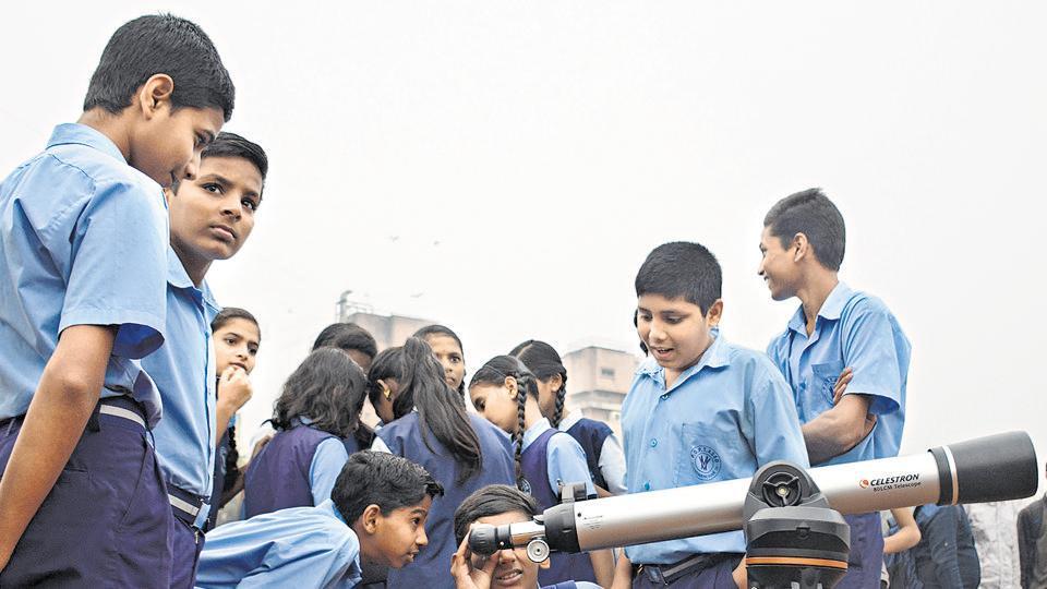 Students from Madhyamik Vidyaliya, Erandawane watch the annual solar eclipse at COEP on Thursday.