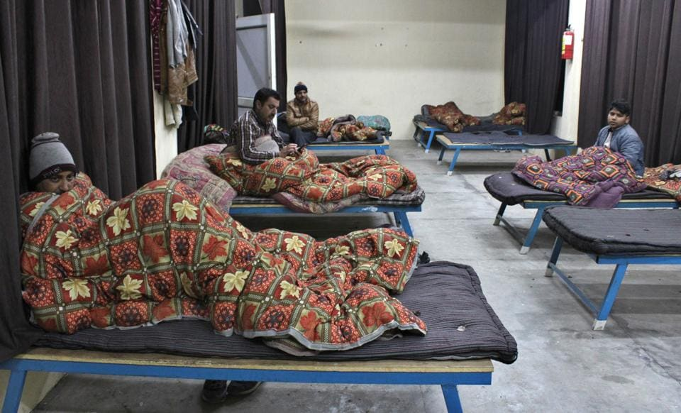 People at the night shelter in Mohali on Thursday.