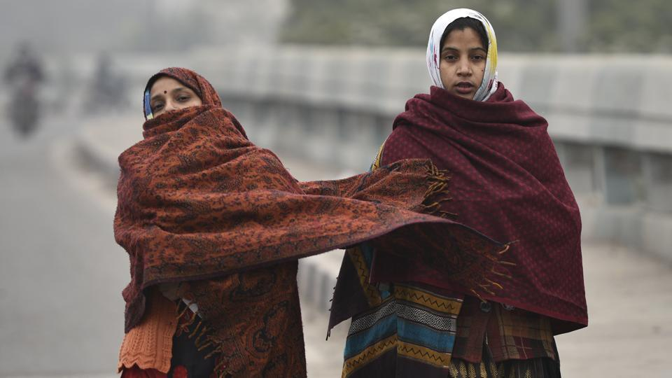 Women seen wrapped in shwals and woollens as the national capital witnesses intense cold conditions, in New Delhi, India, on Thursday, December 26, 2019.