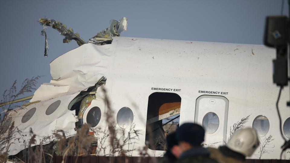 Emergency and security personnel are seen at the site of a plane crash near Almaty, Kazakhstan.