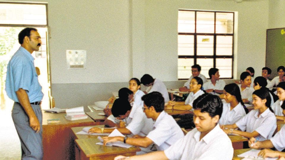 students and teacher in a class room