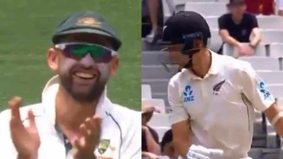 Nathan Lyon laughs as Trent Boult looks for the ball.