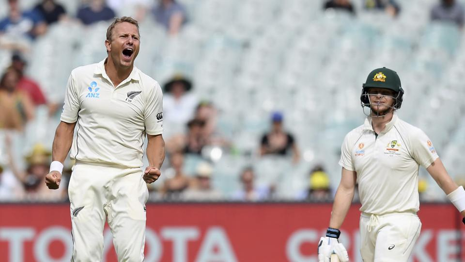 New Zealand's Neil Wagner, left, celebrates capturing the wicket of Australia's Steven Smith, right, during their cricket test match in Melbourne, Australia, Saturday, Dec. 28, 2019..