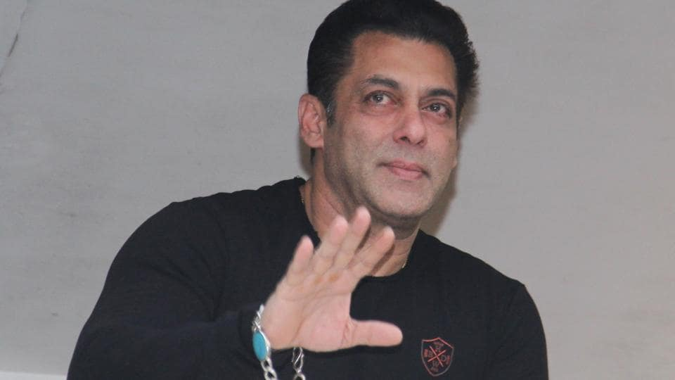 Actor Salman Khan comes out in his balcony to greet fans who had gathered outside the Galaxy Apartments to wish him on his 54th birthday.