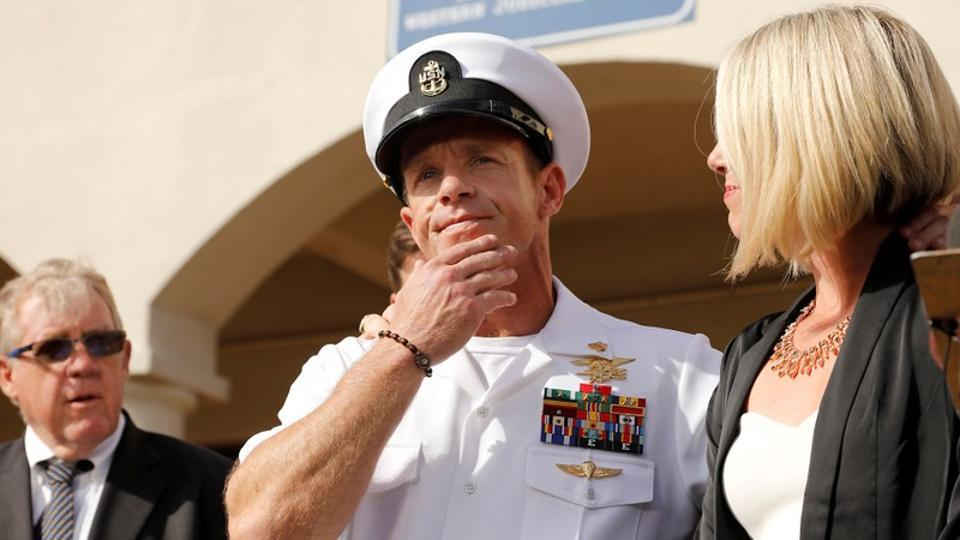 US Navy SEAL Special Operations Chief Edward Gallagher prepares to answer a question from the media with wife Andrea Gallagher after being acquitted on most of the serious charges against him during his court-martial trial at Naval Base San Diego.