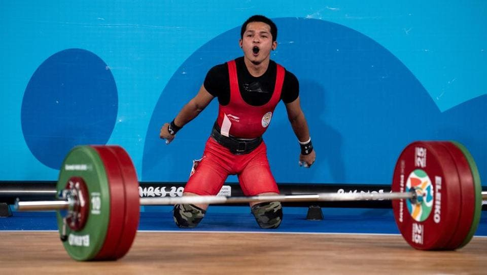 Lalrinnunga Jeremy IND roars in delight after taking the Gold Medal with a successful lift of 150kg.