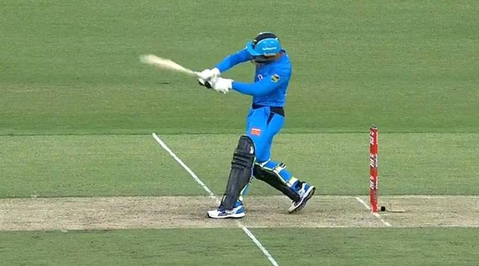 Rashid Khan comes out to bat with the new 'camel' bat.
