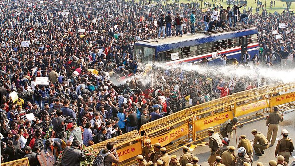 Police use water cannons to disperse demonstrators at protests against the gang-rape and murder of a 23-year-old woman in Delhi on December 16, 2012