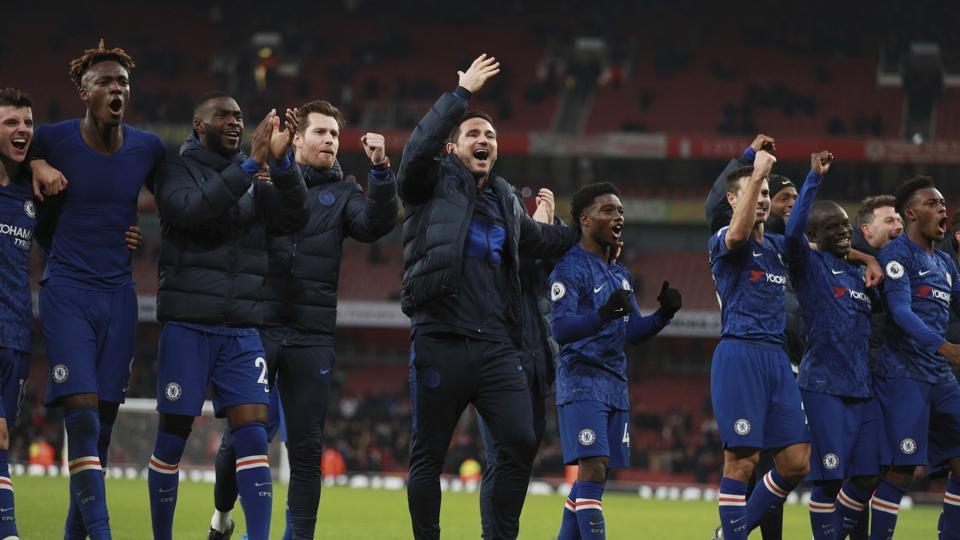 Chelsea's head coach Frank Lampard celebrates with team players.
