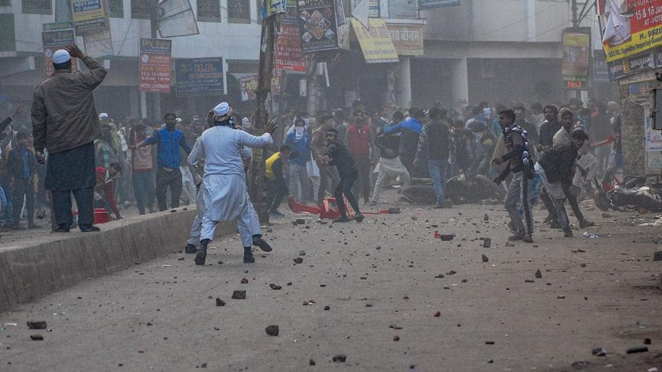 Protestors pelt stones during a rally against the Citizenship Amendment Act (CAA), in Kanpur.