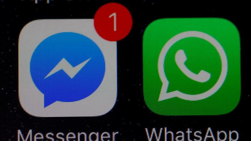 WhatsApp and Facebook messenger icons are seen on an iPhone.