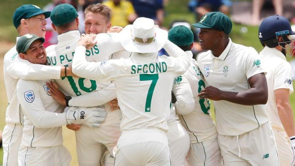 South Africa's Dwaine Pretorius celebrates taking the wicket of England's Joe Denly with teammates.
