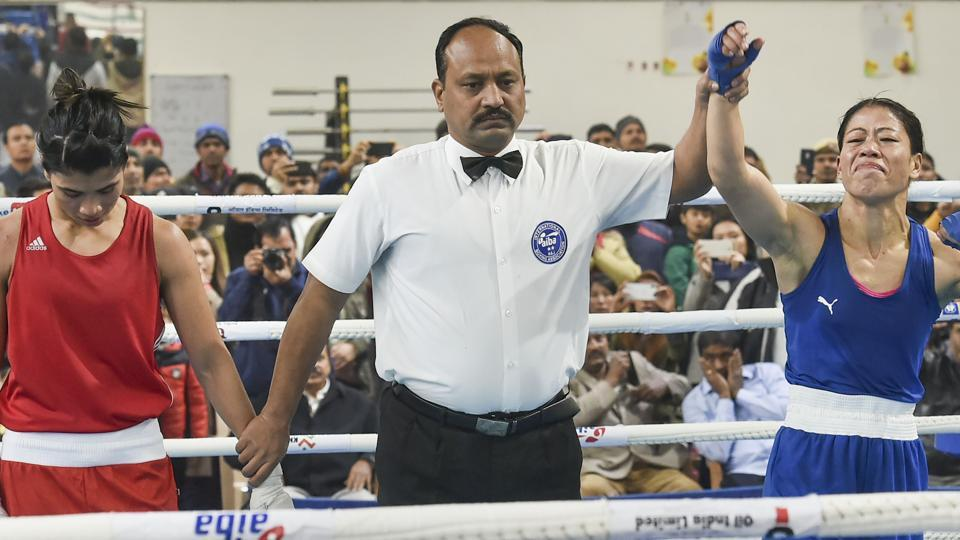 Referee raises the hand of boxer Mary Kom after her bout against Nikhat Zareen.