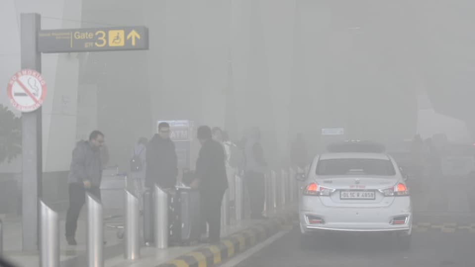 People seen at T3 during a heavy foggy and cold winter morning at IGI Airport, in New Delhi on Dec 30, 2019. (Photo by Sanjeev Verma)