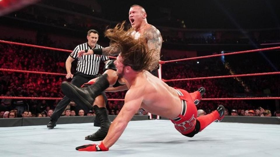 A file photo of Randy Orton (L) and AJStyles.
