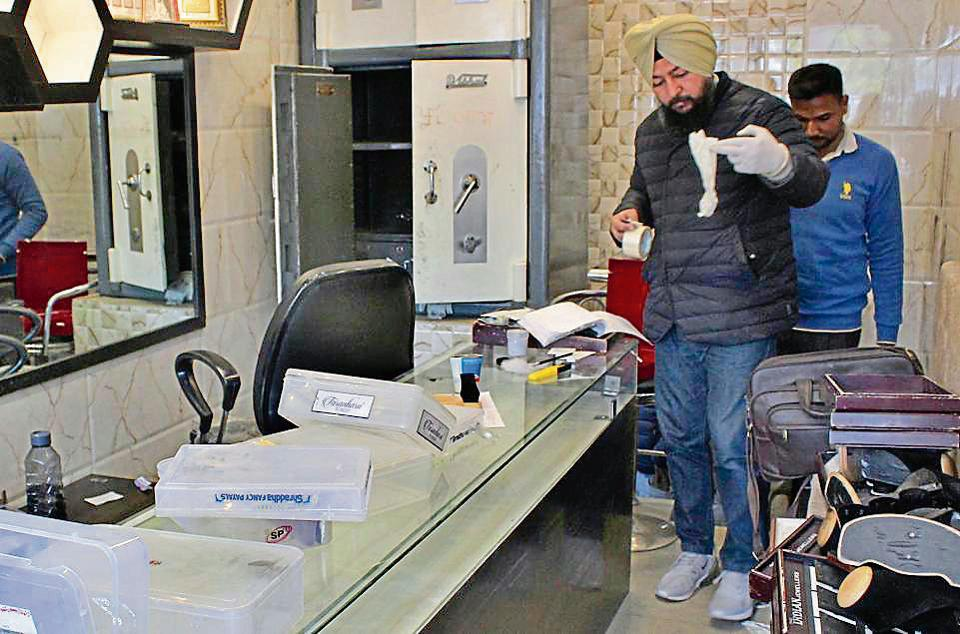 A forensic team collecting samples after the robbery at The Indian Jewellers in Phase 10, Mohali, on Monday. The owner and his son were present in the shop when robbers struck.